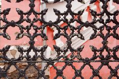 Old building with openwork grunge old rusty black painted metal texture cracked lattices. The architectural element of the decoration of the old building royalty free stock photos