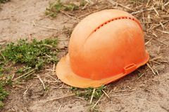 Old building helmet on the ground stock images