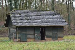 Old building in a petting zoo. An old building for goats in a Dutch petting zoo stock images