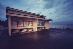 Old building on promenade next to the sea Royalty Free Stock Photo