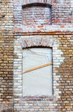 Old building renovation. Closed windows on weathered brick wall - renovation Royalty Free Stock Photos