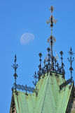Old building roof and moon Royalty Free Stock Photos