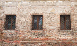 Old building ruine, windows. Abandoned building from red brick and broken windows Royalty Free Stock Photography