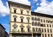 Old building with shutters in Florence, Italy Stock Photos