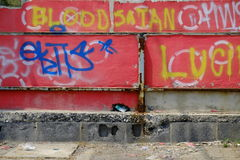 Blood Satan. An old building spray painted with the words blood Satan Royalty Free Stock Images