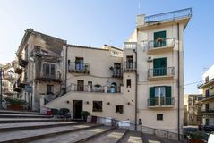 Old building on the stairs. In Lascari, Sicily island, Italy Stock Photos