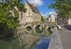 Old building, stone bridge and river in historic quarter of Chartres, France Stock Images