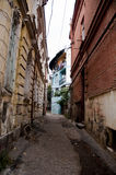 Old building and streets  bit green ground Tbilisi Stock Images