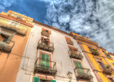 Old building under clouds in Bosa, Sardinia Stock Photos