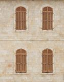 Old building wall with covered windows Royalty Free Stock Image