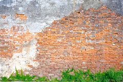 The old building wall that has a slag of cement makes the brick behind.exterior brick walls old buildings decorated with plaster stock photography