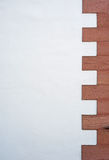 Old building wall with pattern. Old building wall with regular brick pattern on one side Stock Photography