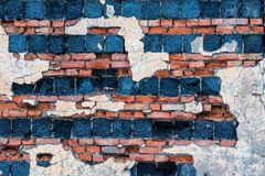 The old building wall of red bricks and blocks. With the parts of plaster Stock Images
