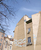 Old building wall with a street art mural in Belgrade Royalty Free Stock Image