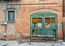 Old building wall with wondow and wood door Stock Photo
