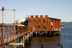 Old Building on Water, Astoria, OR Royalty Free Stock Photo