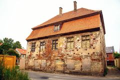 Old building. The windows are bricked up stock image