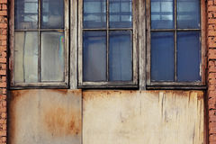 Old building windows. Glass wooden and brick texture background Retro vintage white and red blue royalty free stock photo