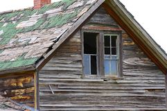 Old building windows and roof. Old dilapidated building windows and roof. Old western homestead Royalty Free Stock Photography
