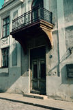 Old Building With A Delicate Balcony And A Wooden Door, Tallinn, Estonia Stock Image