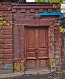 Old building with wooden doors Royalty Free Stock Image