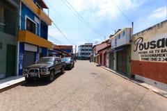 Old buildings along road, Manaus, Brazil. Old buildings in perspective along road, Manaus, Brazil. Brazilian town amazon amazonas amazonia america asphalt blue royalty free stock images