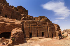 Old buildings of ancient Petra in the background of blue sky. Stock Photos