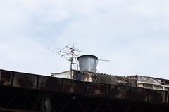 Old buildings and antenna. In the sky Stock Photo