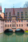 Old buildings and arch bridge reflected in water. Nuremberg, Bavaria Royalty Free Stock Photos