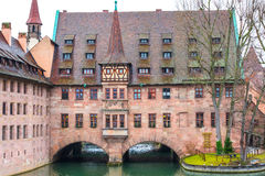 Old buildings and arch bridge reflected in water. Nuremberg, Bavaria Stock Images