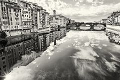 Old buildings and beautiful Ponte Santa Trinita mirrored in the Royalty Free Stock Photo