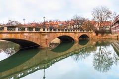 Old buildings and bridge reflected in water. Nuremberg, Bavaria Stock Images