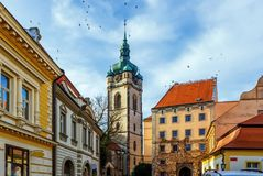 Old buildings and church in Melnik, Czech republic. Old square with buildings and the tower of Church of Saint Peter and Paul in winter, royal town Melnik stock photos