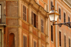 Old buildings in city of Rome. With streetlight or lamp in foreground, Italy Stock Photos