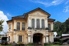 Old style building in Phuket Town, Phuket, Thailand. Old buildings decorated in Portugal are being destroyed in Phuket Town, Thailand Royalty Free Stock Image