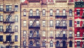 Old buildings with fire escapes, NYC. royalty free stock photos