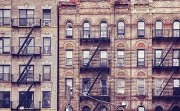 Old buildings with fire escapes in New York City. royalty free stock image