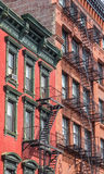 Old buildings with fire stairs in New York Royalty Free Stock Photos