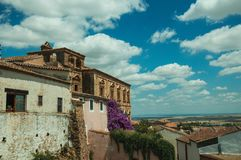 Old buildings and flowering trees with a countryside landscape at Caceres. Old buildings and flowering trees with a countryside landscape in the background at stock image