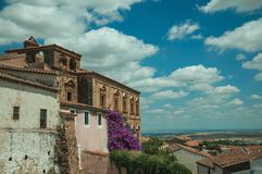 Old buildings and flowering trees with a countryside landscape at Caceres. Old buildings and flowering trees with a countryside landscape in the background at stock images