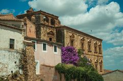 Old buildings and flowering trees with a countryside landscape at Caceres. Old buildings and flowering trees with a countryside landscape in the background at royalty free stock images