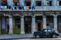 Old buildings in Havana, Cuba. HAVANA, CUBA - NOVEMBER 11, 2013: An old apartment building on Malecón, one of the most famed attractions in Havana, Cuba. Malec Royalty Free Stock Image