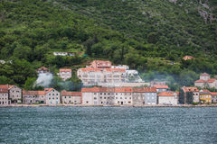 Old Buildings in Kotor with Smoke from Fireplaces Royalty Free Stock Photos