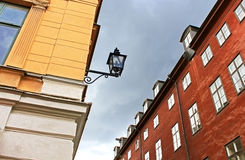 Old buildings and lantern on the street of Stockholm Stock Photography
