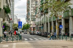 Old buildings in Macau street, with people royalty free stock photos