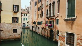 Old buildings and a narrow canal for boats and gondolas in Venice. A typical example of the architecture of Venice