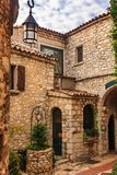 Old buildings and narrow cobblestone streets in a picturesque me. Dieval city of Eze Village in South of France along Mediterranean Sea royalty free stock images