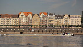 Old buildings near the river in Europe, ships are sailing stock footage