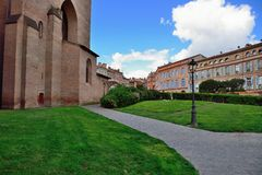 Old buildings next to Cathedrale Saint-Etienne, Toulouse. Small public garden and old buildings next to Cathedrale Saint-Etienne, Toulouse, France Royalty Free Stock Photos
