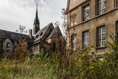 Old buildings and overgrown garden Royalty Free Stock Images